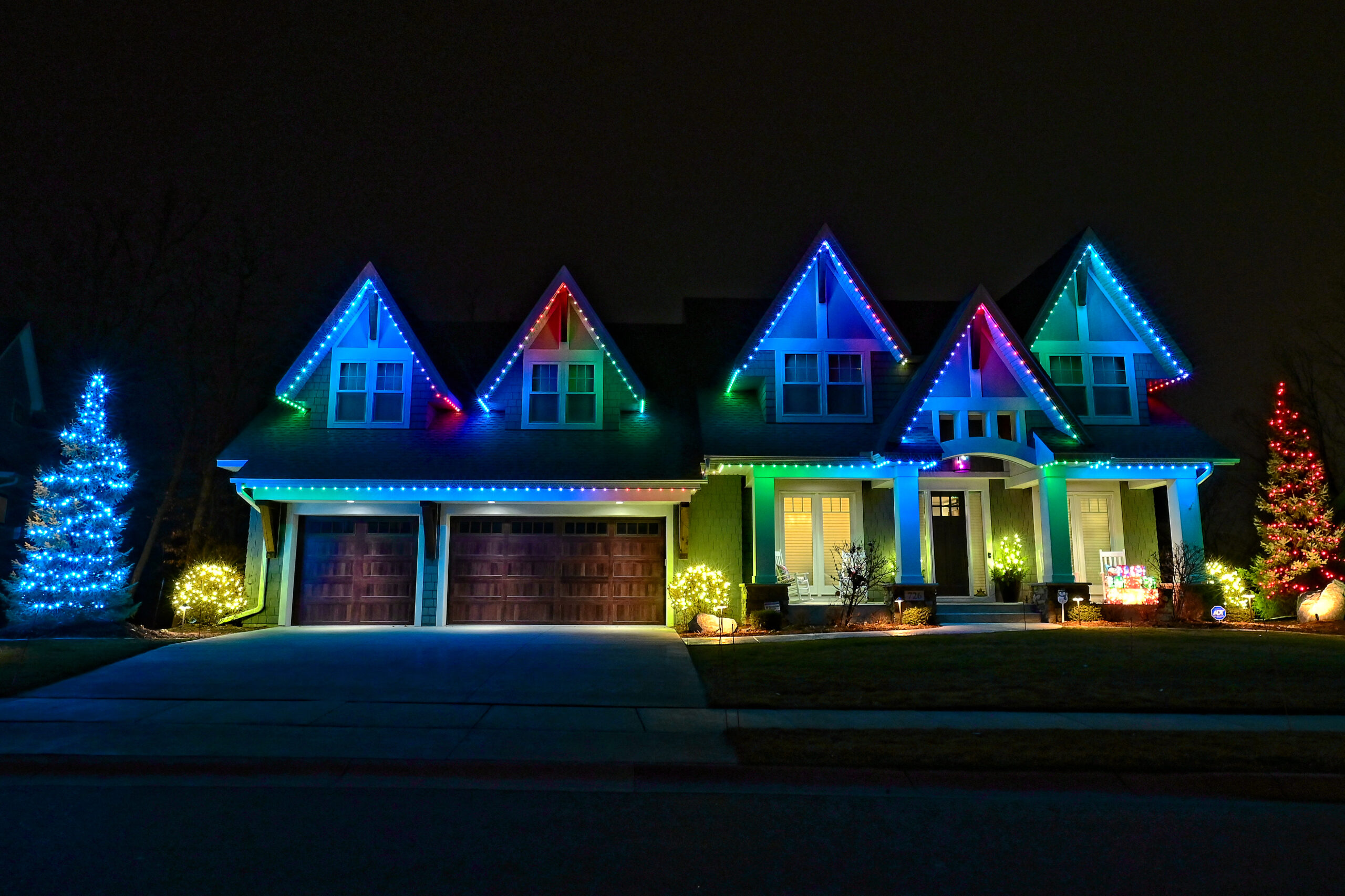 Central Florida Trimlight lighting permanent outdoor programmable lighting system installed on a house.